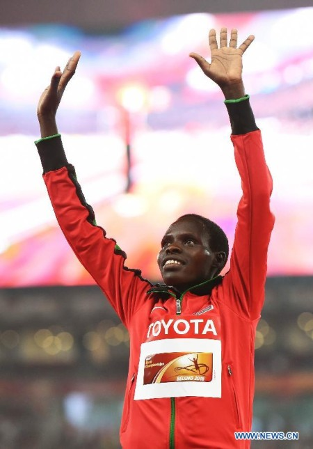 """Silver medalist Kenya's Helah Kiprop celebrates during the awarding ceremony of the women's marathon event at the 2015 IAAF World Championships at the """"Bird's Nest"""" National Stadium in Beijing"""