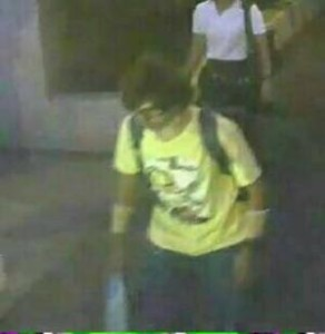 A man wearing a yellow T-shirt and carrying a backpack is seen walking near the Erawan shrine, where a bomb blast killed 22 people on Monday, in Bangkok, Thailand in this handout still image taken from closed-circuit television (CCTV) footage, released by the Thai Police on August 18, 2015.