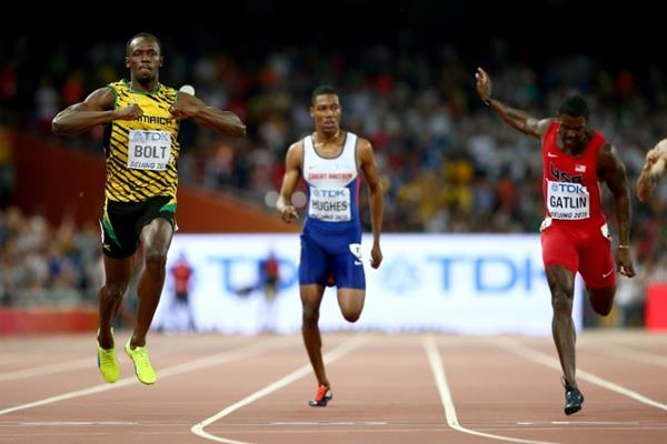 Bolt, left, chest thumping after beating Gatlin again