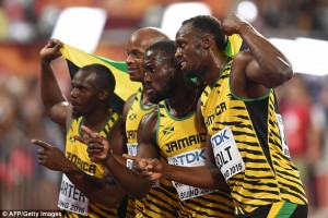 Usain Bolt, right, with other team mates after sweeping the 100 metres gold