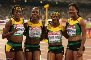 Fraser-Pryce,  second right, with other mates