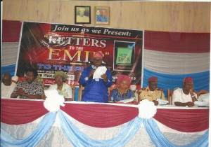 Akogun Iyiola Oyedepo (standing) flanked by some dignitaries at the book launch