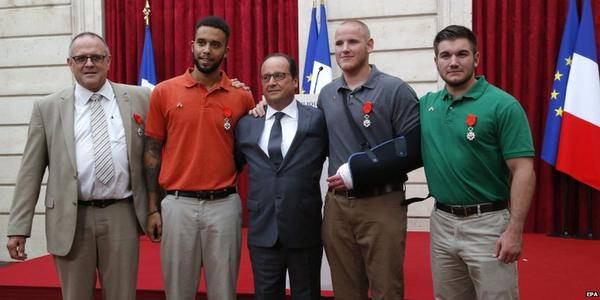 President Francois Hollande with the heroes