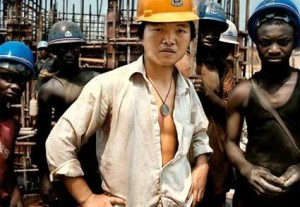 A Chinese staff of Tongyi and the Nigerian workers