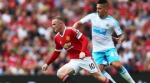 Wayne Rooney escapes from a Newcastle player