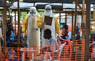 File; Health officers attending to people during the Ebola   outbreak in Liberia