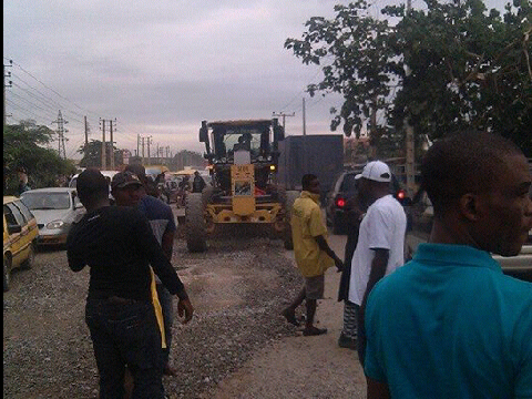 Ongoing repairs on the Ikorodu-Sagamu Road by officials of the Lagos State Government.