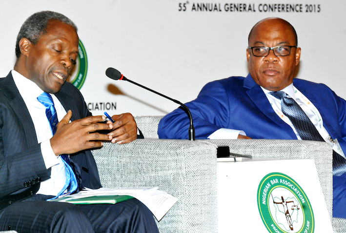 Osinbajo, with Olisa Agbakoba speaks at the conference