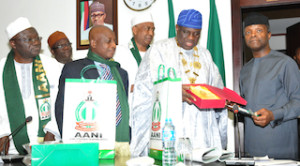VP Osinbajo being presented a gift by the President of the Alumni Association of the National Institute, Lawrence Onoja