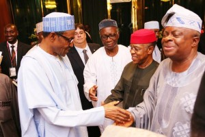 President Muhammadu Buhari in handshake with President Manufactural association of Nigeria, Dr Frank S.U. Jacobs, Vice President Lagos Zone/National Treasurer, Mr Isaac Agoye and others after meeting  with President at the State house in Abuja. PHOTO; SUNDAY AGHAEZE