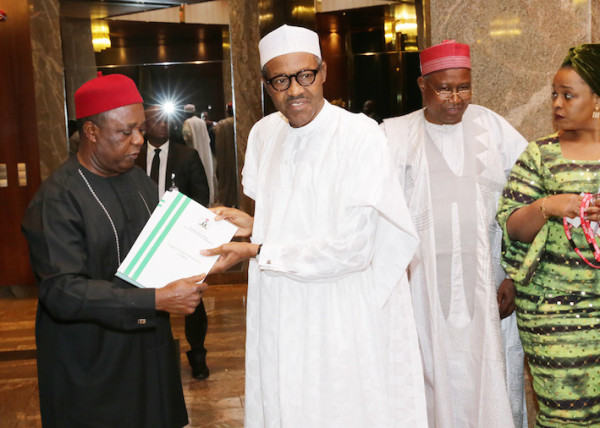 President Buhari receives the RMAFC report on cost of governance, from Chairman, Elias Bam