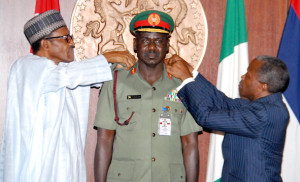 Buratai, middle being decorated by President Buhari, left and VP Osinbajo recently