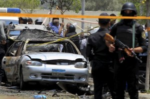 File photo: Policemen secure the site of a car bomb attack in Cairo
