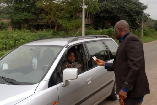 Fayose stops a civil servant driving late to work and checks his ID