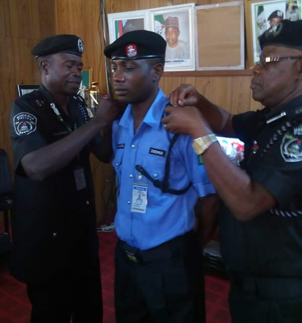 Sergeant Hosea being decorated with new title