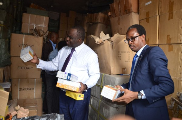 File Photo: NAFDAC officials examine fake products