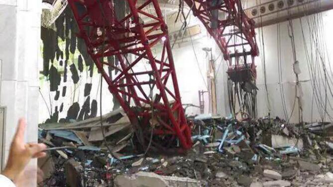 A general view from inside the Grand Mosque showing a part of a large crane that collapsed on the mosque on 11 September 2015.