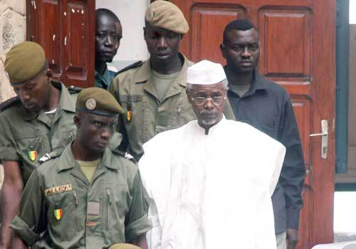 Hissene Habre, in white: shouts in court as indictment read