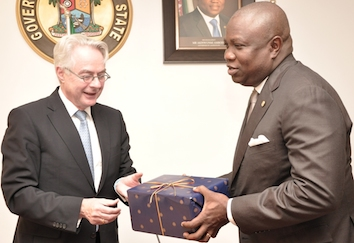 Lagos State Governor, Mr. Akinwunmi Ambode (right) receiving a gift from the Ambassador of Republic of Germany to Nigeria, Mr. Michael Zenner (left)