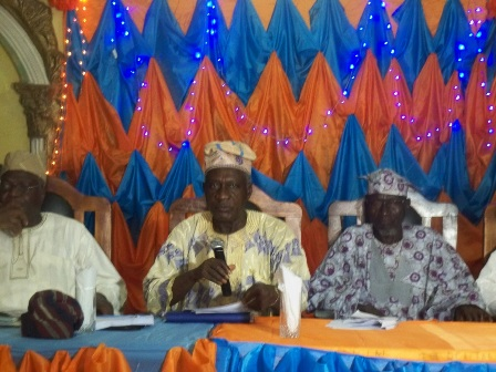 Bishop Ayo Ladigbolu, in the middle,  supported by Chief Hassan Orantola and Prince Salau Olokijibi