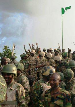 happy troops with the Nigerian flag