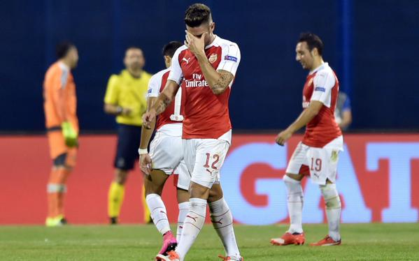 Giroud walks out, after the red card