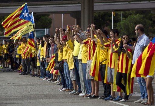 File: Catalans link arms in a bid to create a 400-kilometre (250-mile) human chain, part of a campaign for independence from Spain during Catalonia National Day, on September 11, 2013.