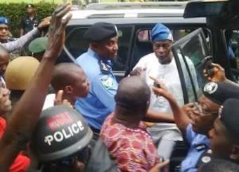 Falae, in white, with IGP Solomon Arase, arriving home in Akure after a four-day kidnapping ordeal