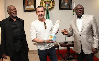 Ambode presenting an eyo plaque to Hollywood actor, Mr. Alastair Mackenzie
