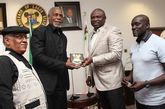 Lagos State Governor, Mr. Akinwunmi Ambode (2nd right) presenting a state plaque to Veteran Hollywood Film Producer, Mr. Danny Glover (2nd left), the Producer/Director of the movie 93Days, a film on Ebola Virus, Mr. Sleve Gukas (right) and his Co-producer, 93days & the Director, Dusable Museum USA, Mr. Pemon Rami (left) during a courtesy visit to the Governor by the Cast and Crew of the film 93Days, at the Lagos House, Ikeja, on Wednesday, September 23, 2015.