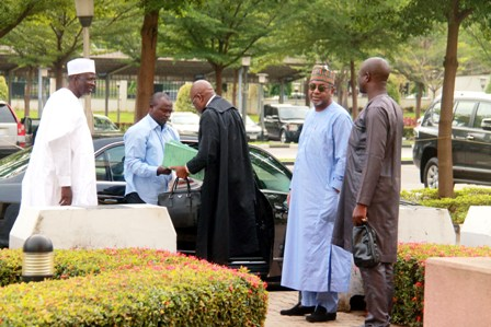 Dasuki  and one of his lawyers, Ahmed Raji (SAN). In white is Attahiru Bafarawa, former governor of Sokoto State, arriving the court