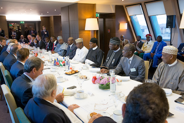 President Buhari and the Nigerian delegation at a meeting with French businessmen in Paris