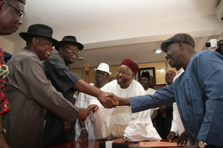 Governor Dickson (2nd left) first civilian Governor of the State, Chief Diepreye Alamieyeseigha (left), exchanging peasantries with PDP executives during the Governor's submission of expression of interest and nomination forms, while the PDP National Organising Secretary, Alhaji Abubaka Mustapha (2nd right) looks on.