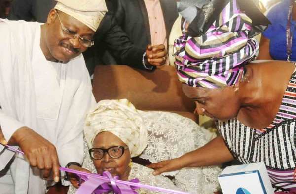 Governor Abiola Ajimobi with Hannah at the inauguration of a printing Press for Nigerian Tribune in March 2015