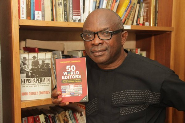 Mike Awoyinfa with a copy of World Editors written with Dimgba