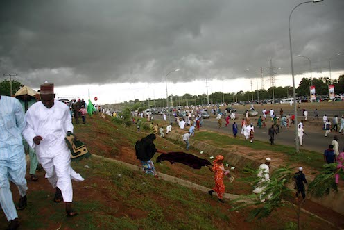 Another view of muslims escaping from the rain in Abuja. Photo: Femi Ipaye