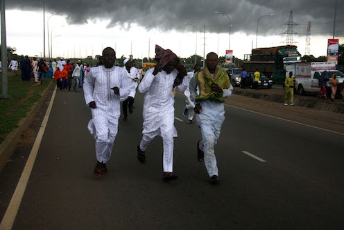 Muslim faithful running for cover in Abuja