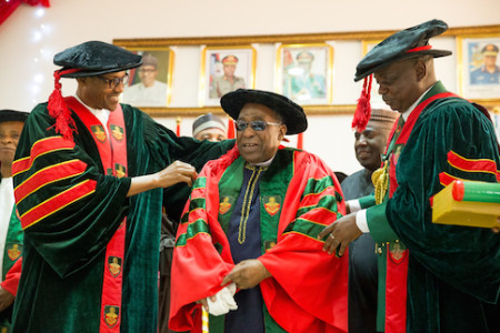 President Muhammadu Buhari assisted by Commandant Nigerian Defence Academy Maj. Gen. MT Ibrahim as the President conferred upon Malam Yusuf Maitama Sule Honorary Doctor of Letters during the NDA convocation in Kaduna on 12th Sept 2015