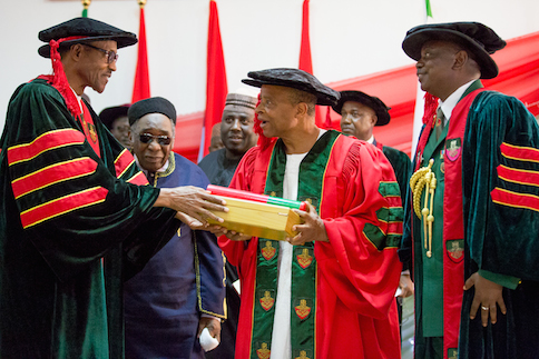 President Muhammadu Buhari assisted by Commandant Nigerian Defence Academy Maj. Gen. MT Ibrahim as the President conferred upon Lt. Gen.  Alani Akinrinade Honorary doctor of Management Sciences