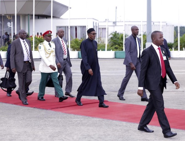 Buhari walking to the plane on the way to paris, France