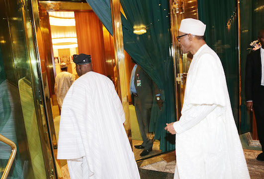 President Obasnjo moving into an inner room for the private talk with Buhari, who follows him. Photo Sunday Aghaeze