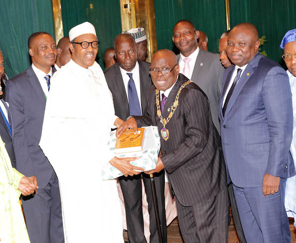 A book gift from ICAN to Buhari