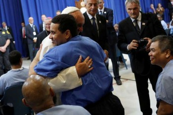 Pope Francis embraces a prisoner while meeting with inmates at Curran-Fromhold Correctional Facility in Philadelphia, September 27, 2015 (Reuters)