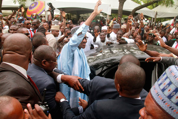 Man of the people: Buhari  at the praying ground in Abuja last July