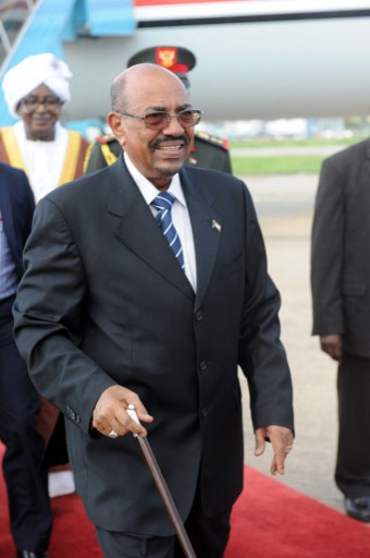 Sudan's President Omar al-Bashir arrives at the Nnamdi Azikiwe International Airport in Abuja on July 14, 2013 to take part in a African Union summit about HIV, TB and malaria. Nigeria is a member of The Hague-based International Criminal Court, which in 2009 and 2010 issued two warrants against Bashir for war crimes, genocide and crimes against humanity allegedly committed in Sudan's Darfur region. Nations that have signed on to the world's only permanent court for war crimes and crimes against humanity have a legal obligation to arrest any indicted suspect found within their territory.    AFP PHOTO/PIUS UTOMI EKPEI