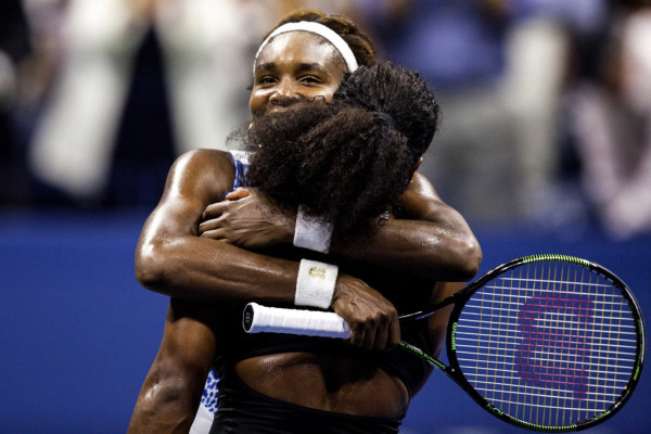Serena and Venus embrace after the show