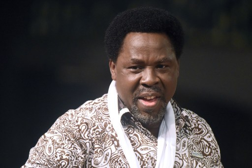 Nigerian pastor TB Joshua speaks during a New Year's memorial service for the South African relatives of those killed in a building collapse at his Lagos megachurch on December 31, 2014.  A spokesman at Joshua's Synagogue Church of All Nations (SCOAN) said 44 South Africans have flown to Lagos to attend the ceremony following the September disaster which killed 116 people, including 81 South Africans.