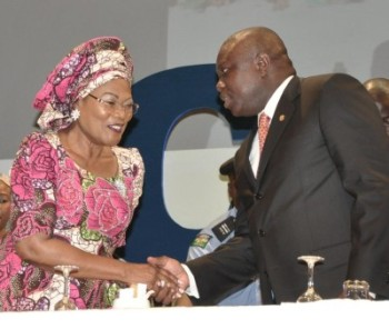 Lagos State Governor, Mr. Akinwunmi Ambode (right) in a warm handshake with Osun State Deputy Governor, Mrs. Titi-Laoye Tomori during the closing ceremony of the National Women Conference 2015 with the theme: Relevance in Economic Turbulence, organized by COWLSO, at the Convention Centre, Eko Hotels & Suite on Friday, September 18, 2015.