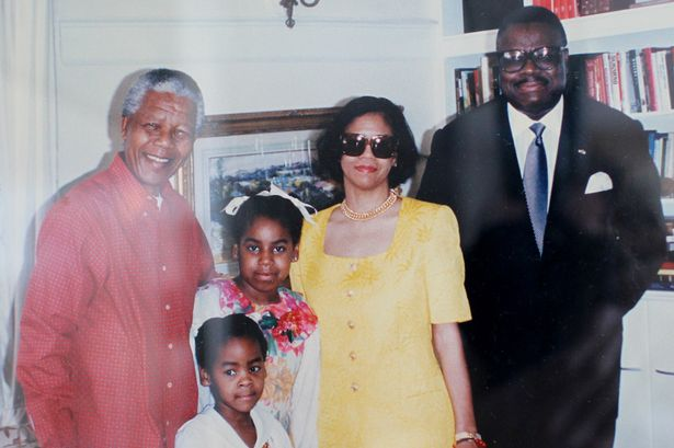 Frenandez, right and family with Africa's icon, Nelson Mandela, left