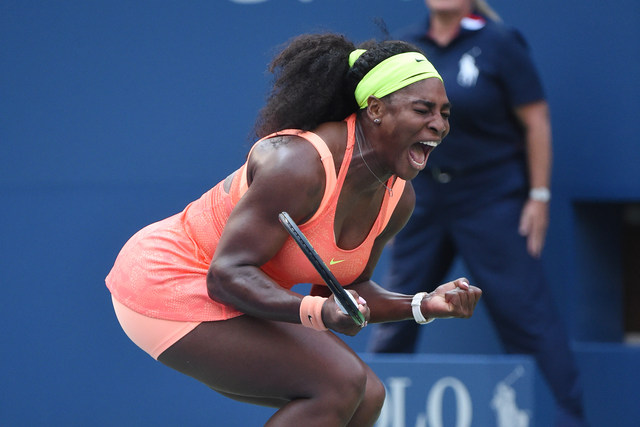 Serena Williams screams after winning a point